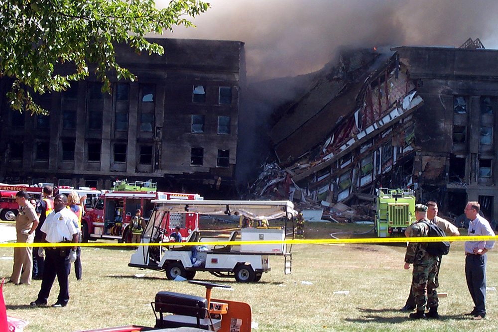"""The plane that hit the Pentagon, Sept. 11, 2001, peeled the building's reinforced concrete back all the way to the """"B"""" Ring. The area outside the Pentagon became a staging area for medical and emergency personnel. © Jim Garamone, DOD"""